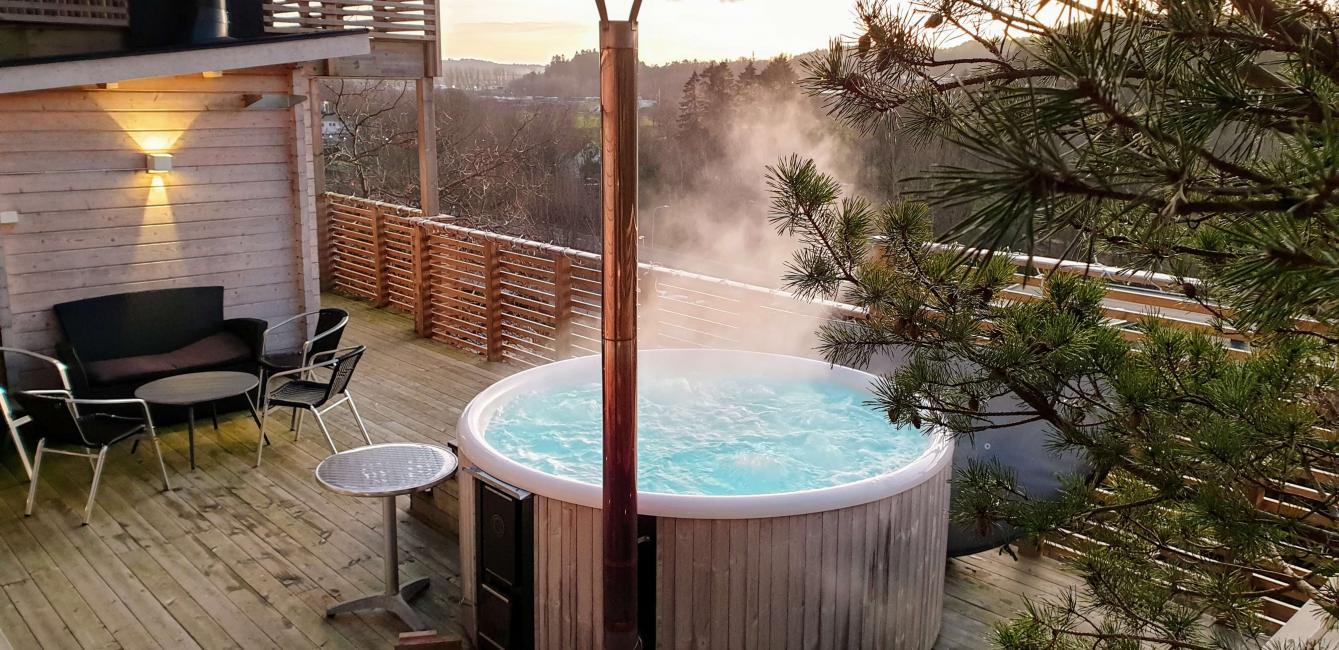 with wood-fired sauna and hot tub and magical views